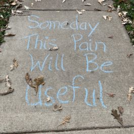 Chalk on sidewalk: Someday this pain will be useful